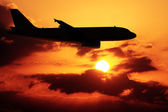 Airplane in a sunset — Stockfoto