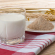 Glass of milk and wheat ears — Stock Photo