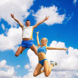 The sportsman in a jump against the sky - Stock Photo