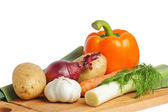 Vegetables on a wooden kitchen board — Stock Photo