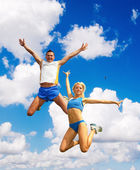 The sportsman in a jump against the sky — Stock Photo