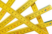 Yellow collapsible ruler of the carpenter — Stock Photo