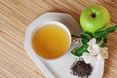 Still-life with green tea and an apple — Stock Photo