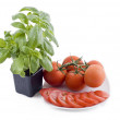 Royalty-Free Stock Photo: Fresh basil and plate of tomatos