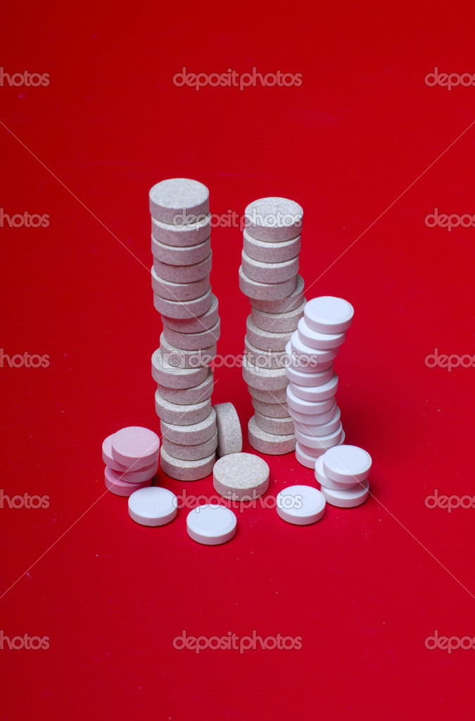 Grey and white tablets solid tower on dark background.  — Stock Photo #3765343