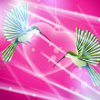 Hummingbirds flying around pink heart — Stock Photo