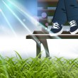 Royalty-Free Stock Vector Image: Child sitting on a bench