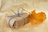 Gift and autumn sheet — Stock Photo