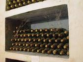 Wine bottles in the cellar — Stock Photo