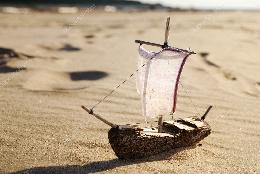 Ship toy model on the beach  Stock Photo #3792829