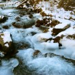 The storming river in winter time — Stock Photo