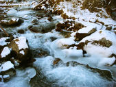 The storming river in winter time — Стоковое фото