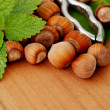 Stock Photo: Hazelnuts with pincers