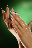 Hands of a young woman with a nice manicure. — Stock Photo