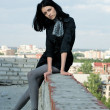 Young woman on roof — Stock Photo #3788243