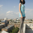 Young woman on roof — Stock Photo