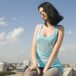 Young woman on roof — Stock Photo #3790697