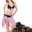 Girl in swimming suit with suitcase - Stock Photo
