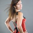 Young woman in corset — Stock Photo