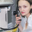 Stock Photo: Womworking on telecommunication equipment