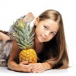 Little girl with pineapple — Stock Photo #3765167