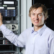 Datacenter specialist showing web server cluster — Stock Photo #3765188