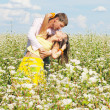 Royalty-Free Stock Photo: Young couple on field of flowers