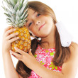 Stock Photo: Little girl with big pineapple