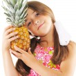 Stock Photo: Little girl and pineapple