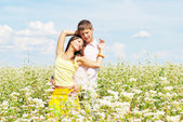 Beautiful young couple among the flowers — Stock Photo