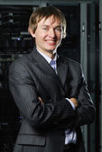 Young IT manager in front of server equipment — Stockfoto