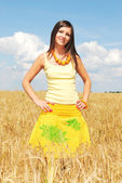 Girl in a yellow field of wheat — Stock Photo