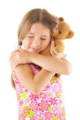 Little girl hugging bear toy — Stock Photo