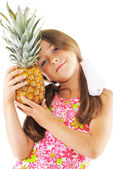 Little girl and pineapple — Stock Photo