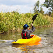 Stock Photo: Boy canoeing
