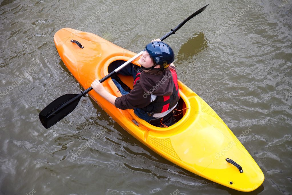 Young girl canoeing on the local waterways  Stock Photo #3827914