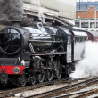 Steam train at platform - Stock Photo