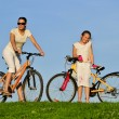 Royalty-Free Stock Photo: Mother and her dauhgter riding on a bicycles