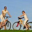 mother and her dauhgter riding on a bicycles — Stock Photo #3822793