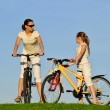Stock Photo: mother and her dauhgter riding on a bicycles