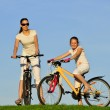 mother and her dauhgter riding on a bicycles — Stock Photo #3822813