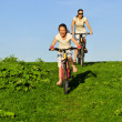 Mother and her dauhgter riding on a bicycles - Photo