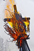 Cross in the fire (burning of maslenitsa) — Stock Photo