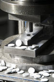 Aluminium circles on a press machine — Stock Photo