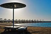 Straw umbrellas on the beach of Egypt — Stock Photo