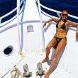 The beautiful woman has a rest on the yacht — Stock Photo