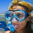 The beautiful girl is snorkeling with a mask in a red sea — Stock Photo