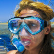 The beautiful girl is snorkeling with a mask in a red sea — Stock Photo #3830744