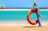 Life buoy on the beach of Egypt — Stock Photo