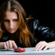 Hot girl playing with a model of the red sport car. — Stock Photo #3854379